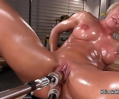 Big tits oiled Milf bangs machine