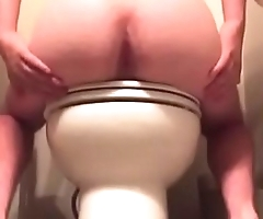showing ass in a public bathroom