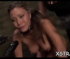 Roped lassie takes on a massive strapon