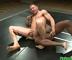Wrestling black hunk gets a hj from maledom