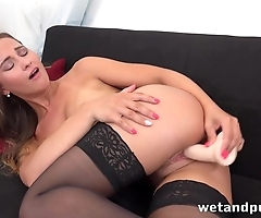 Teen with perky tits tests dildo in the living room