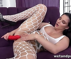Mischievous gal in lingerie toys cunt with red dildo