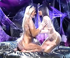 Massage rubbing with hot brunette and blonde lesbians